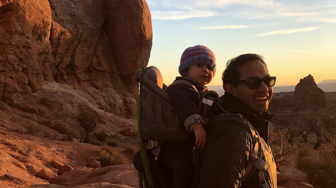Arcadia CEO Kiran Bhatraju stands with his baby in Canyonlands National Park in Utah.