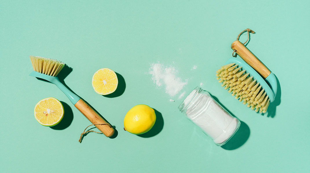 Cleaning supplies - lemons, scrub brushers, and baking soda