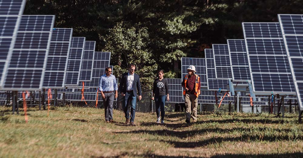 Arcadia CEO Kiran Bhatraju walks among the solar panels at the opening of the Goat Island community solar farm in Rhode Island